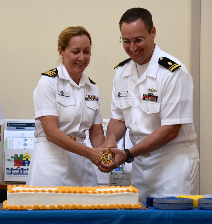 U.S. Navy Cdr. Amy Smith, director, Public Health Services, Naval Health Clinic Charleston, and Lt. j.g. Aaron Mehlberg, NHCC Radiation Health Officer, cut the cake during NHCC's birthday celebration for the Medical Service Corps Aug. 4, 2016 at NHCC, JB Charleston - WS. (Navy photo by Seaman Kelen Kloss)