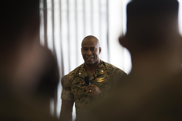 U.S. Marine Corps Lt. Col. Jabari Reneau, commanding officer of Marine All-Weather Fighter Attack Squadron (VMFA)-242, speaks about the outbound and incoming sergeants major at Marine Corps Air Station Iwakuni, Japan, Aug. 12, 2016. Reneau honored the ceremony in seeing off Sgt. Maj. Jason L. Kappen, outbound sergeant major of VMFA(AW)-242 and welcoming Sgt. Maj. James L. Shadle. (U.S. Marine Corps photo by Lance Cpl. Joseph Abrego)