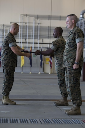 U.S. Marine Corps Lt. Col. Jabari Reneau, commanding officer of Marine All-Weather Fighter Attack Squadron (VMFA)-242, commences the passing of the sword of office to Sgt. Maj. James L. Shadle at Marine Corps Air Station Iwakuni, Japan, Aug. 12, 2016. A relief and appointment ceremony was held to welcome the incoming and see off the outbound sergeants major. (U.S. Marine Corps photo by Lance Cpl. Joseph Abrego)