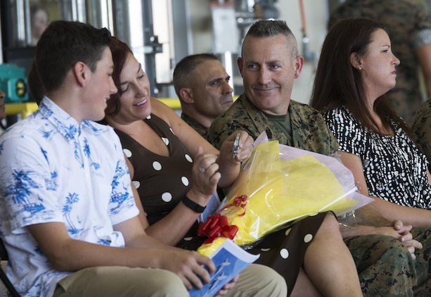 "U.S. Marine Corps Sgt. Maj. Jason L. Kappen, outbound sergeant major for Marine All-Weather Fighter Attack Squadron (VMFA)-242, sits with his family after being relieved of his duties at Marine Corps Air Station Iwakuni, Japan, Aug. 12, 2016. Kappen said after working with VMFA(AW)-242, also known as the ""Bats,"" he will always remember the Marines' commitment to mission accomplishment regardless of circumstances and cannot wait to see what Shadle does with the unit.  (U.S. Marine Corps photo by Lance Cpl. Joseph Abrego)"