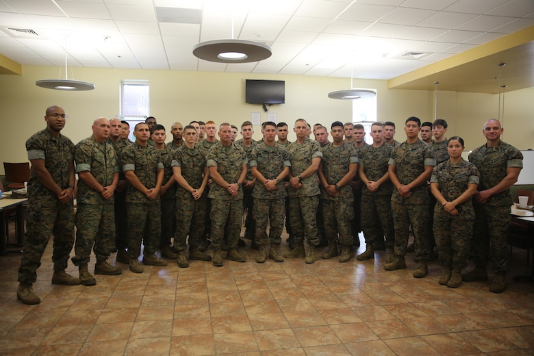 Marines involved with Marine Air Control Group 28's Corporals Course, accompanied by Col. Thomas Dodds (second left), Sgt. Maj. Richard Thresher (middle left), Brig. Gen. Matthew Glavy (middle right) and Sgt. Maj. Rogelio De Leon (far right) stand together after sharing a meal at the mess hall aboard Marine Corps Air Station Cherry Point, N.C., Aug. 9, 2016. Brig. Gen. Matthew Glavy and Sgt. Maj. Richard Thresher had breakfast with the Marines while discussing leadership and the role of noncommissioned officers in mission accomplishment for the Marine Corps. Thresher is the command sergeant major and Glavy is the commanding general for 2nd Marine Aircraft Wing. Glavy is the commanding general and Thresher is the command sergeant major for 2nd Marine Aircraft Wing, while Dodds is the commanding officer for MACG-28 and De Leon is the sergeant major for Marine Tactical Air Command Squadron 28. (U.S. Marine Corps photo by Lance Cpl. Mackenzie Gibson/Released)