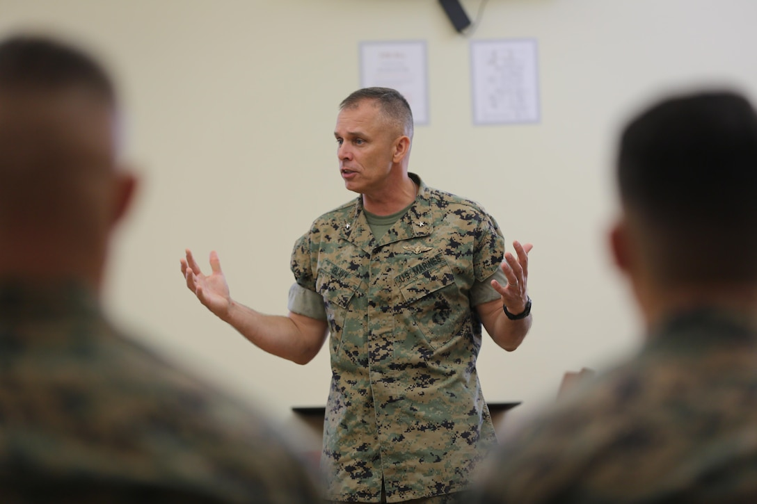 Brig. Gen. Matthew Glavy shares a few words with Marines assigned to Marine Air Control Group 28's Corporals Course after sharing a meal at the mess hall aboard Marine Corps Air Station Cherry Point, N.C., Aug. 9, 2016. Glavy and Sgt. Maj. Richard Thresher had breakfast with the Marines while discussing leadership and the role of noncommissioned officers in mission accomplishment for the Marine Corps. Glavy is the commanding general and Thresher is the command sergeant major for 2nd Marine Aircraft Wing. (U.S. Marine Corps photo by Lance Cpl. Mackenzie Gibson/Released)