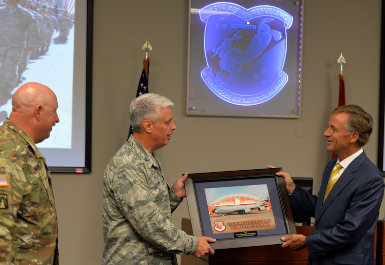 Maj. Gen. Terry M. Haston, the Adjutant General of Tennessee National Guard and Col. Thomas Cauthen, 134th Air Refueling Wing Commander present a 134th ARW picture to Tennessee Governor Bill Haslam while visiting the 134th Operations Group July 27, 2016 at McGhee Tyson ANG Base, Knoxville, Tenn. (U.S. Air National Guard photo by Staff Sgt. Daniel Gagnon)