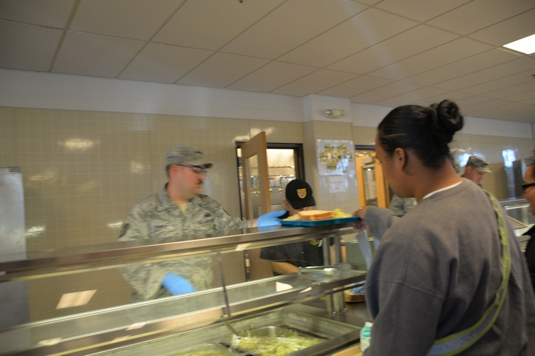 Tech. Sgt. Jacob Daniels from the 134th Air Refueling Wing Force Support Squadron volunteers at the Military Youth Academy Dining Facility during a temporary duty assignment to Joint Base Elmendorf-Richardson Alaska, July 10-19. Members from FSS helped prepare and serve food three times a day for the cadets. (U.S. Air National Guard photo by: Senior Airman Melissa Dearstone)
