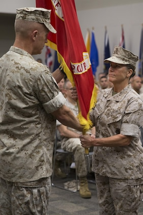 Brig. Gen. Helen G. Pratt (right), incoming commander of 4th Marine Logistics Group, receives the colors from Brig. Gen. Patrick J. Hermesmann (left), former commander of 4th MLG, during the change of command ceremony at the Federal City Auditorium, New Orleans, Aug. 13, 2016. While addressing the attendees of the ceremony, Hermessman expressed his total confidence in Pratt as the new commander. (U.S. Marine Corps photo by Lance Cpl. Melissa Martens/ Released)