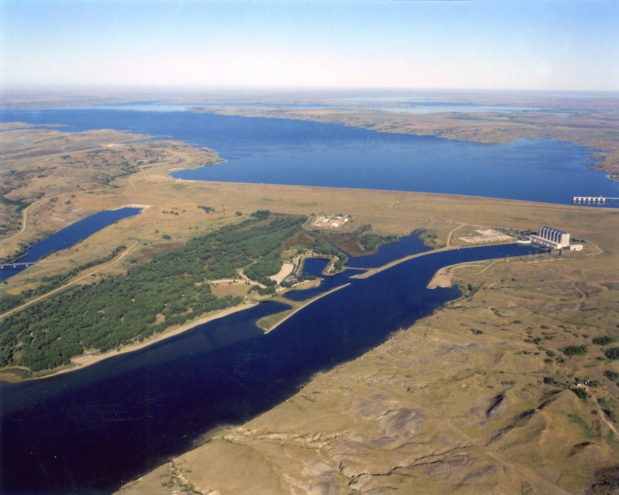 Oahe Dam is located near Pierre, S.D. at River Mile 1,072.3. The first of the power house's seven 89,500-kilovolt generators was put into operation in March 1962.  On August 17, 1962, President John F. Kennedy came to the dam and officially dedicated the two generators.  The final generator went into operation in June 1963, completing the $340-million Oahe project.  By 1966, Oahe Dam was generating over 2 billion kilowatt-hours of electricity annually.