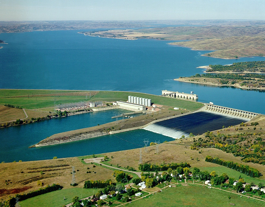 The Fort Randall Dam power house went into operation on  March 15, 1954. President Dwight D. Eisenhower spoke over the radio from the White House to 600 people gathered in the Fort Randall power house tapping a Western Union key to signal to Governor Sigurd Anderson to start the generators. Anderson spun the giant turbine, and the dam's first generator began producing electricity. By the early 1970s, the dam was producing over 2 billion kilowatt-hours of electric power annually.
