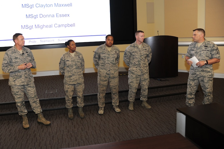 Air Force District of Washington Commander Maj. Gen. Darryl Burke and CMSgt. Tommy Mazzone, AFDW Command Chief, recognize MSgt. Donna Essex, MSgt Migheal Campbell and MSgt. Clayton Maxwell for their support of the 2016 SNCO Induction Ceremony during the AFDW Commander's Call on Aug. 12, 2016. The event recognized recent individual and team accomplishments while focusing on the significant challenges facing the AFDW team over the next few months. (U.S. Air Force photo/Jim Lotz)