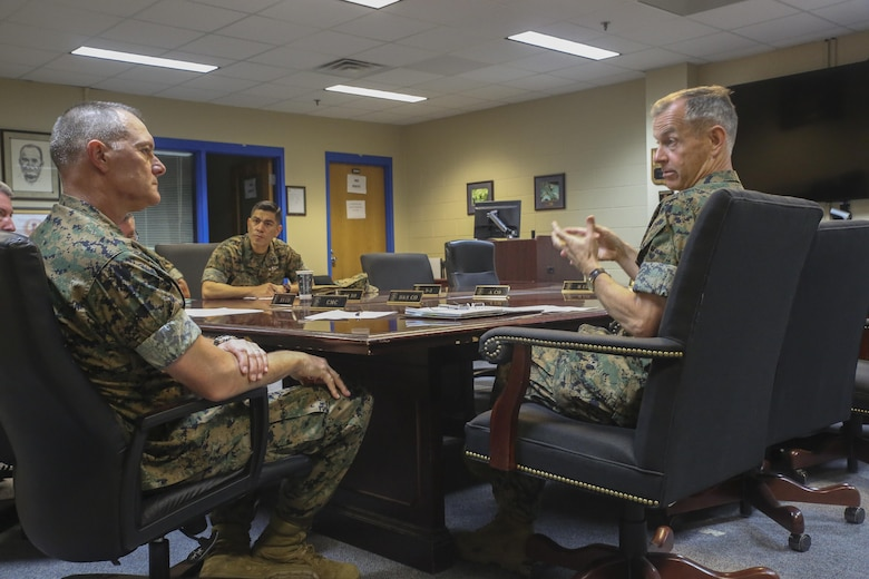 Navy Rear Adm. Stephen Pachuta, right, the Medical Officer of the Marine Corps, speaks to sailors from 2nd Medical Battalion at Camp Lejeune, N.C., Aug. 9. Pachuta visited several units across Marine Corps Installations-East, evaluating medical readiness and operational procedures throughout II Marine Expeditionary Force. (U.S. Marine Corps photo by Sgt. Lucas Hopkins)