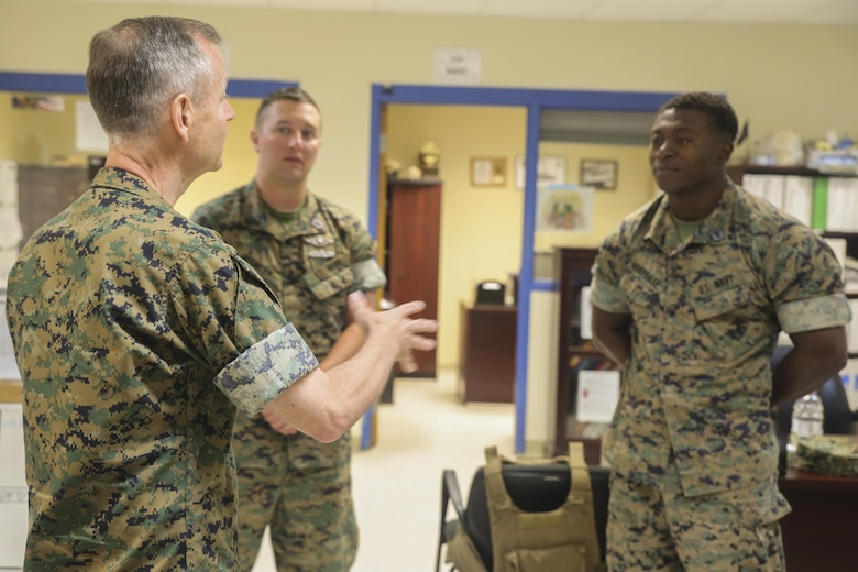 Navy Rear Adm. Stephen Pachuta, left, the Medical Officer of the Marine Corps, speaks to Hospitalman 1st Class Walter Wiencek, center, and Hospitalman 3rd Class Francis Nukpoafe, right, both with 2nd Medical Battalion, at Camp Lejeune, N.C., Aug. 9, 2016. Pachuta addressed medical readiness and operational procedures with key leaders from throughout II Marine Expeditionary Force, while also greeting corpsman with various units. (U.S. Marine Corps photo by Sgt. Lucas Hopkins)