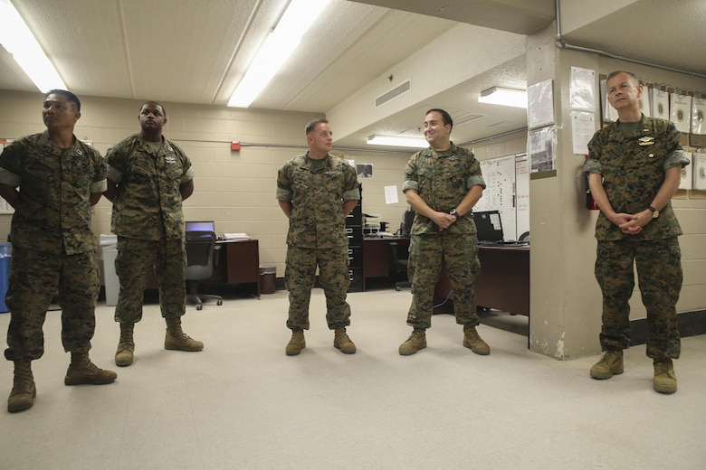 Navy Rear Adm. Stephen Pachuta, right, the Medical Officer of the Marine Corps, meets with sailors from 2nd Medical Battalion at Camp Lejeune, N.C., Aug. 9. In order to evaluate and enhance medical procedures, Pachuta spoke to key leaders and engaged with junior sailors from across II Marine Expeditionary Force. (U.S. Marine Corps photo by Sgt. Lucas Hopkins)