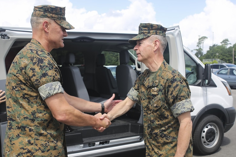 Navy Rear Adm. Stephen Pachuta, right, the Medical Officer of the Marine Corps, shakes hands with Navy Capt. Brian Tolbert, left, the commanding officer of 2nd Medical Battalion, at Camp Lejeune, N.C., Aug. 9. Pachuta addressed medical readiness and operational procedures with key leaders from throughout II Marine Expeditionary Force, while also greeting corpsman with various units. (U.S. Marine Corps photo by Sgt. Lucas Hopkins)
