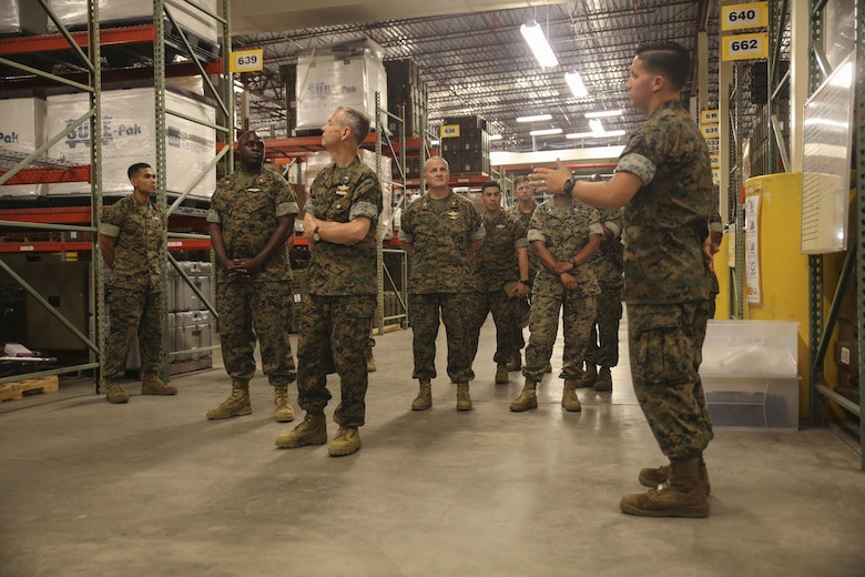Navy Rear Adm. Stephen Pachuta, center, the Medical Officer of the Marine Corps, is briefed on medical supplies and equipment at Camp Lejeune, N.C., Aug. 11. Pachuta addressed medical readiness and operational procedures with key leaders from throughout II Marine Expeditionary Force, while also greeting corpsman with various units. (U.S. Marine Corps photo by Sgt. Lucas Hopkins)