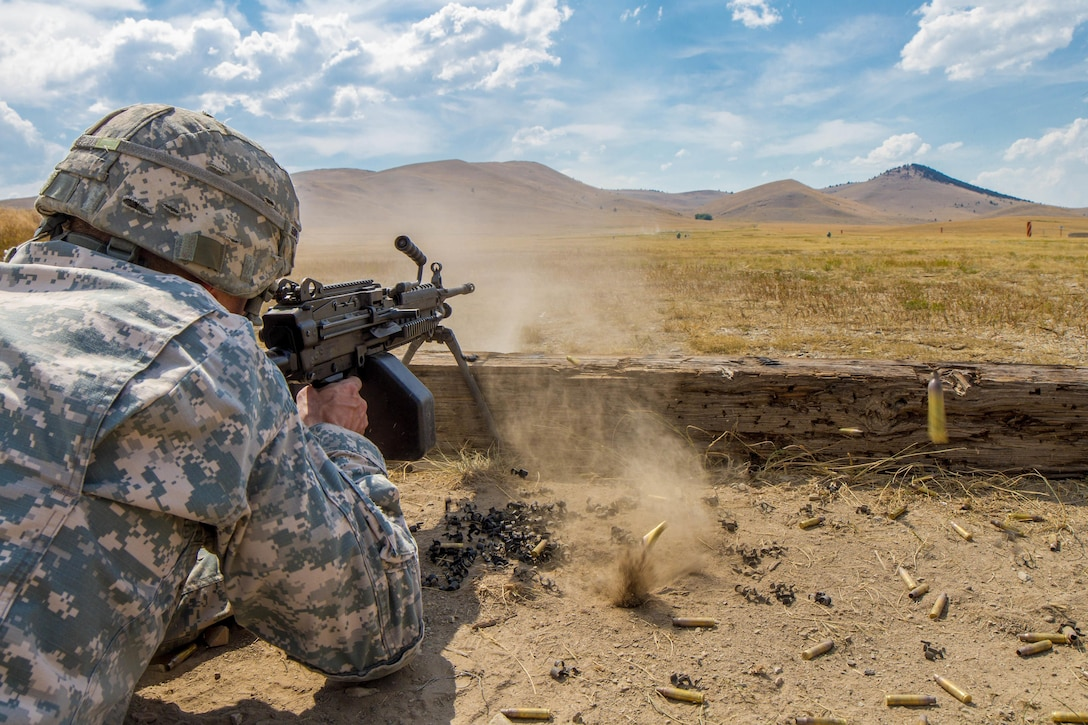 Sgt. 1st Class Robert Jones, 2016 U.S. Army Reserve Best Warrior Competition (BWC) runner up in the noncommissioined officer (NCO) category, fires a M-249 squad automatic weapon at Fort Harrison, Mont., August 8, 2016.  The Army Reserve BWC winners and runners up from the NCO and Soldier categories are going through rigorous training, leading up to their participation in the Department of the Army Best Warrior Competition this fall at Fort A.P., Va.