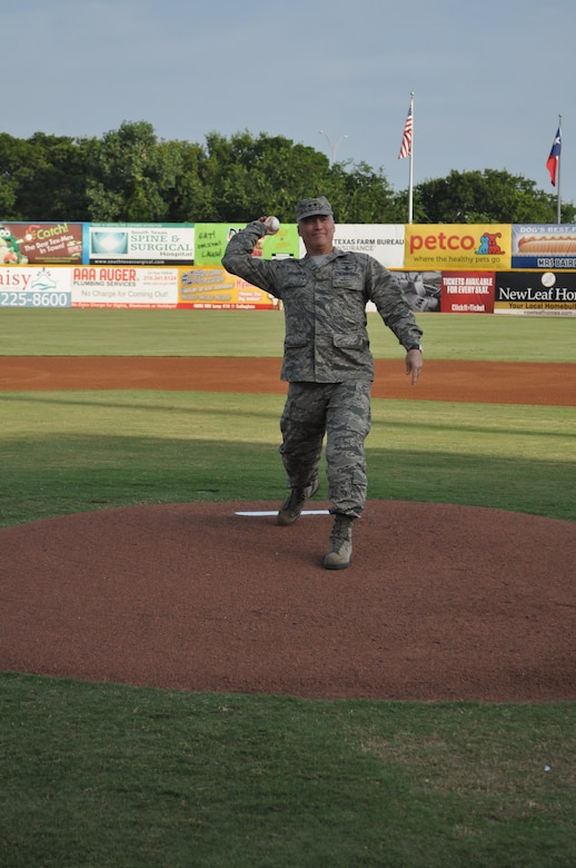 Maj. Gen. James K. McLaughlin, 24th Air Forces' third commander, throws the first pitch during a minor league baseball game between the San Antonio Missions and the San Diego Padres in San Antonio July 2013 (Courtesy photo).