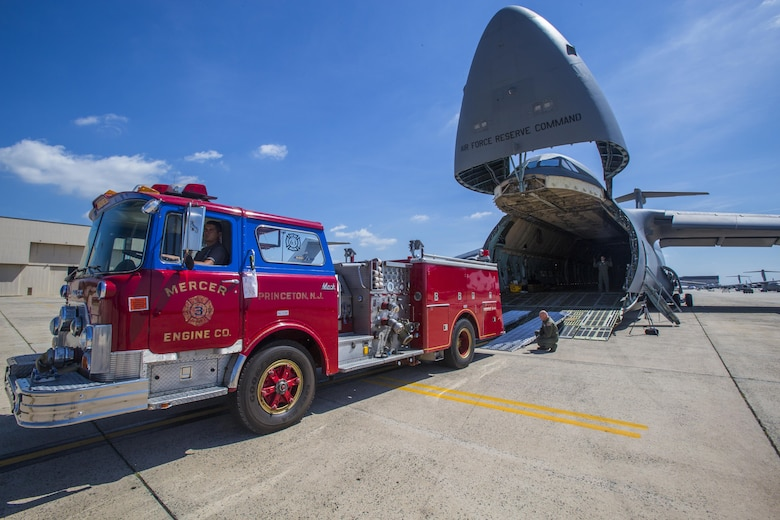 Loadmasters with the 439th Airlift Wing load a 1982 Mack fire truck onto a C-5B Galaxy at Joint Base McGuire-Dix-Lakehurst New Jersey, on Aug. 12, 2016. The truck will be flown to Managua, Nicaragua. Master Sgt. Jorge A. Narvaez, a New Jersey Air National Guardsman with the 108th Security Forces Squadron, was instrumental in getting the truck donated to a group of volunteer firefighters in Managua. The 439th AW is located at Westover Air Reserve Base, Mass.