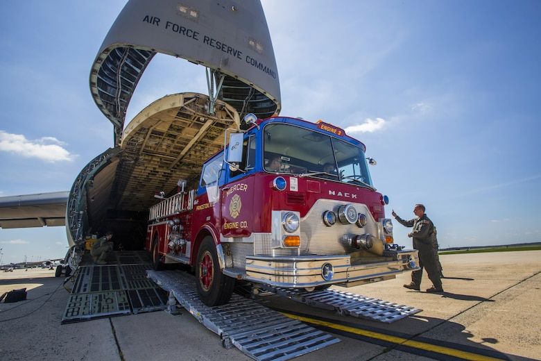 Loadmasters with the 439th Airlift Wing, load a 1982 Mack fire truck onto a C-5B Galaxy at Joint Base McGuire-Dix-Lakehurst New Jersey, on Aug. 12, 2016. The truck will be flown to Managua, Nicaragua. Master Sgt. Jorge A. Narvaez, a New Jersey Air National Guardsman with the 108th Security Forces Squadron, was instrumental in getting the truck donated to a group of volunteer firefighters in Managua. The 439th AW is located at Westover Air Reserve Base, Mass.