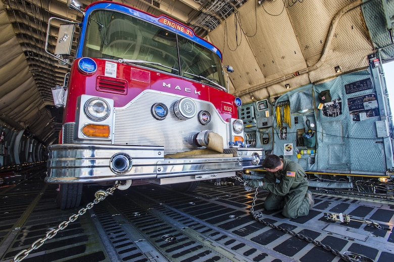 Loadmasters with the 439th Airlift Wing load a 1982 Mack fire truck onto a C-5B Galaxy at Joint Base McGuire-Dix-Lakehurst N.J., on Aug. 12, 2016. The truck will be flown to Managua, Nicaragua. Master Sgt. Jorge A. Narvaez, a New Jersey Air National Guardsman with the 108th Security Forces Squadron, was instrumental in getting the truck donated to a group of volunteer firefighters in Managua. The 439th AW is located at Westover Air Reserve Base, Mass.