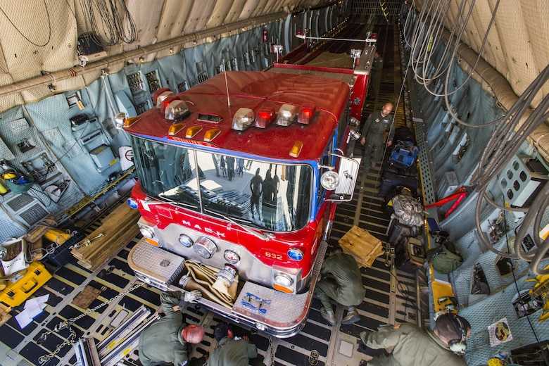 Loadmasters with the 439th Airlift Wing secure a 1982 Mack  fire truck onto a C-5B Galaxy at Joint Base McGuire-Dix-Lakehurst N.J., on August 12, 2016. The truck will be flown to Managua, Nicaragua. Master Sgt. Jorge A. Narvaez, a traditional New Jersey Air National Guardsman with the 108th Security Forces Squadron, was instrumental in getting the truck donated to a group of volunteer firefighters in Managua. The truck donation is done through the Denton Program, which allows U.S. citizens and organizations to use space available on military cargo aircraft to transport humanitarian goods to countries in need. The 439th is located at Westover Air Reserve Base, Mass.