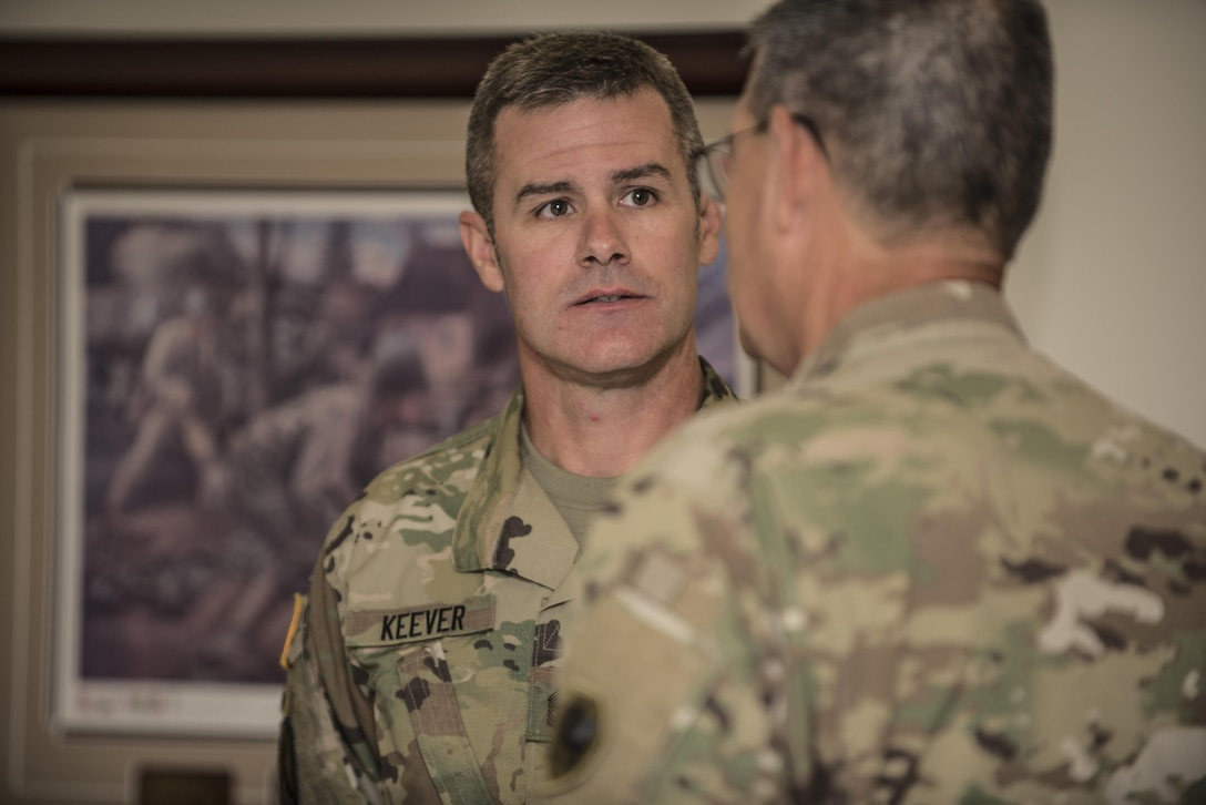 Sgt. 1st Class Bill Keever, Arizona State University ROTC assistant primary military science instructor speaks with Maj. Gen. Mark McQueen, 108th Training Command (IET) commanding general, during a senior leader seminar held at Joint Base Lewis McChord, Wash., Aug. 6. Sixty-seven Military Science Instructors from 150 Universities spread throughout 26 states were present during the seminar as part of an annual training development event designed to tap into senior leader mentoring and motivational techniques as well as provide a forum for the exchange of ideas and best practices. The event was hosted by the 104th Training Division's 4th Battalion, 414th Regiment (SROTC). (U.S. Army Reserve photo by Sgt. 1st Class Brian Hamilton)