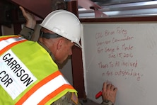 Fort Meade Garrison Commander Col. Tom Foley signs the top piece of steel in the renovation project at building 4554.