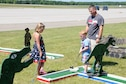 Master Sgt. Nathan Anderson a C-130 Crew Chief with the 910th Maintenance Squadron plays a game of miniature golf with his son Owen, and daughter, Molly, during Family Day here, August 7, 2016. . (U.S. Air Force photo/Tech. Sgt. James Brock)