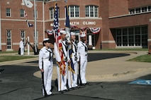 A Navy color guard prepares to present colors before the official start for the change of command ceremony for the Naval Health Clinic Quantico.