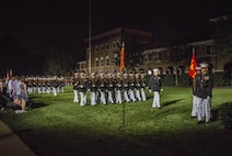 Marines of Marine Barracks Washington D.C. perform pass in review during the Evening Parade at Marine Barracks Washington D.C., Aug. 12, 2016. The guests of honor for the parade were Vice Adm. John Aquilino, deputy chief of Naval Operations, Plans and Strategies, Rear Adm. Linda Fagan, deputy commandant for Operations, Policy and Capabilities, Lt. Gen. William Mayville Jr., director of the Joint Staff, Lt. Gen. Joseph Anderson, joint staff deputy Chief of Staff, Lt. Gen John Raymond, deputy chief of Staff and Operations, and Maj. Gen James Witham, director of Domestic Operations and Force Development. The hosting official for the parade was Lt. Gen. Ronald Bailey, deputy commandant for Plans, Policies and Operations. (Official Marine Corps photo by Lance Cpl. Robert Knapp/Released)