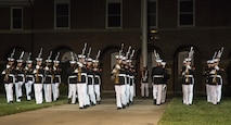 The United States Marine Corps Silent Drill Platoon performs during the Evening Parade at Marine Barracks, Washington, D.C., Aug. 12, 2016. The guests of honor for the parade were Vice Adm. John Aquilino, deputy chief of Naval Operations, Plans and Strategies, Rear Adm. Linda Fagan, deputy commandant for Operations, Policy and Capabilities, Lt. Gen. William Mayville Jr., director of the Joint Staff, Lt. Gen. Joseph Anderson, joint staff deputy Chief of Staff, Lt. Gen John Raymond, deputy chief of Staff and Operations, and Maj. Gen James Witham, director of Domestic Operations and Force Development. The hosting official for the parade was Lt. Gen. Ronald Bailey, deputy commandant for Plans, Policies and Operations. (Official Marine Corps photo by Lance Cpl. Robert Knapp/Released)