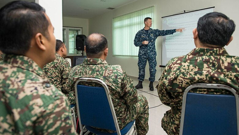 Lt. Cmdr. Justin Campbell, from Thomasville, Alabama, a research psychologist assigned to hospital ship USNS Mercy (T-AH 19),  addresses participants of a Pacific Partnership 2016 operational medicine symposium, Aug 11, 2016.   During the symposium, Malaysian Army service members and Pacific Partnership 2016 personnel discussed mental health issues related to combat deployment, cardiology topics relative to operational platforms within diving, and Malaysian Armed Forces experiences with rapid medical response. This is the first time Mercy and Pacific Partnership have visited Malaysia. During the mission stop partner nations are working side-by-side with local military and civilian organizations in a search and rescue exercise, civil engineering projects, community relation events and subject matter expert exchanges.