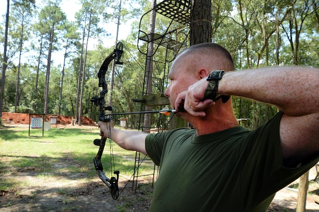 Staff Sgt. John R. Harris Jr., training chief, Headquarters Company East, Marine Corps Logistics Command, sights in his bow during a practice at Marine Corps Logistics Albany's Bow Range, Aug. 4.