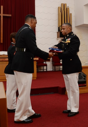 Maj. Gen. Craig Crenshaw (left), commanding general, Marine Corps Logistics Command, serves as the retiring official for Maj. Lee Taylor (right), operations actions officer/mission assurance officer, LOGCOM, in a ceremony at Marine Corps Logistics Base Albany's Chapel of the Good Shepherd, Aug. 12. Taylor, who has devoted 30 years in service to the nation, began his active-duty career in the enlisted ranks, later attended Officer Candidate School and became a Marine commissioned officer in March 2002.