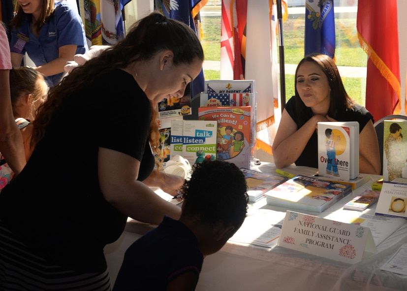 A participant at Beale's Baby Shower reads information offered from the National Guard Family Assistance Program Aug. 13, 2016, at Beale Air Force Base, California. The event provided Team Beale's new and expecting families the opportunity to build relationships with others, participate in baby shower activities and get information from approximately 40 agencies on and off base. The agencies provided services and information such as nutrition assistance, healthy living information, child development and parental education. (U.S. Air Force photo by Airman Tristan D. Viglianco)