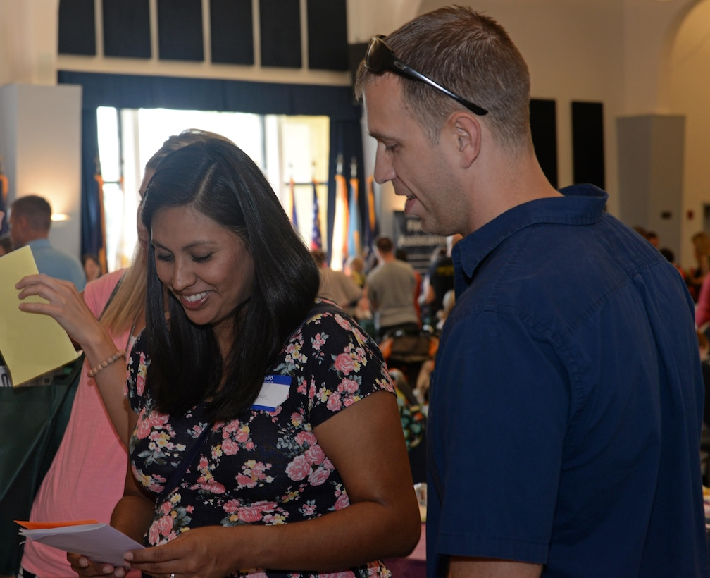 Members of Team Beale receive information about programs offered in the local community during Beale's Baby Shower Aug. 13, 2016, at Beale Air Force Base, California. The event provided Team Beale's new and expecting families the opportunity to build relationships with others, participate in baby shower activities and get information from approximately 40 agencies on and off base. The agencies provide services and information such as nutrition assistance, healthy living information, child development and parental education. (U.S. Air Force photo by Airman Tristan D. Viglianco)