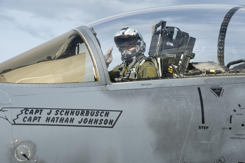 U.S. Air Force Capt. Michael Glatther, an F-15E Strike Eagle pilot assigned to the 336th Fighter Squadron, Seymour Johnson Air Force Base (AFB), N.C., salutes Airman 1st Class Nicholas Proia, an avionics technician assigned to the 4th Aircraft Maintenance Squadron from Seymour Johnson AFB, N.C., from the cockpit, after the equipment on his jet passed inspection in the test cell prior to a sortie at Eielson Air Force Base, Alaska, Aug. 15, 2016, during RED FLAG-Alaska (RF-A) 16-3. Free exchange of ideas between multilateral forces during RF-A enhances not just partners and sister-service relationships, but also their operational efficiency. (U.S. Air Force photo by Staff Sgt. Shawn Nickel)