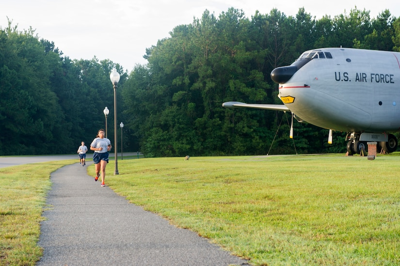 The 628th Comptroller Squadron runs to the back gate for physical training on Joint Base Charleston – Air Base, S.C., Aug. 5, 2016. The 628th CPTS haven't had a failed physical training test in over two years. (U.S. Air Force photo by Airman 1st Class Thomas T. Charlton)