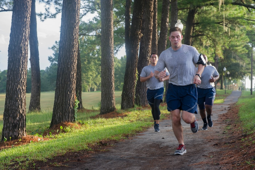Staff Sgt. Gabriel Lazurka, 628th Comptroller Squadron non-commissioned officer in charge of financial services, leads the way for the rest of his squadron as they run the back gate on Joint Base Charleston – Air Base, S.C., Aug. 5, 2016. Besides running, the 628th CPTS do exercises from yoga and spin class, to cross fit and  a variety of other types of physical training during their workout sessions. (U.S. Air Force photo by Airman 1st Class Thomas T. Charlton)