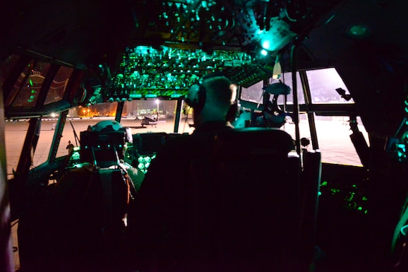 California Air National Guardsmen from the 129th Rescue Wing, Moffett Federal Airfield, Calif., prepares an MC130P Combat Shadow aircraft for a night-time overwater operation, August 12, 2016.  The Guardsmen are preparing for an overwater rescue mission on the Pacific Ocean in response to a seriously ill 37-year-old crewman on board the HMCS Calgary, a Canadian naval frigate, 800 miles off shore from San Francisco. (U.S. Air National Guard photo by Master Sgt. Ray Aquino/released)