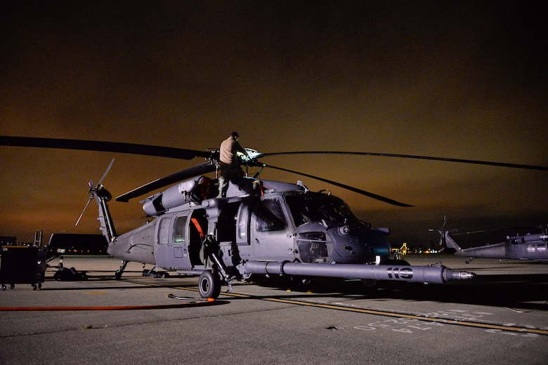 California Air National Guardsmen from the 129th Rescue Wing, Moffett Federal Airfield, Calif., prepares an HH60G Pave Hawk helicopter for a night-time overwater operation, August 12, 2016.  The Guardsmen are preparing for an overwater rescue mission on the Pacific Ocean in response to a seriously ill 37-year-old crewman on board the HMCS Calgary, a Canadian naval frigate, 800 miles off shore from San Francisco. (U.S. Air National Guard photo by Master Sgt. Ray Aquino/released)