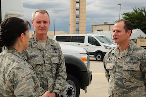 Lt. Gen. Darryl Roberson, commander of Air Education and Training Command, speaks with Col. Eric Froehlich, 377th Air Base Wing commander, and Col. Brenda Cartier, 58th Special Operations Wing commander, prior to his visit to the 150th and 58th Special Operations Wings at Kirtland Air Force Base, N.M., Aug. 5. During his visit, Roberson received an overview of the various mission sets within the wings.  (Photo by Master Sgt. Paula Aragon)