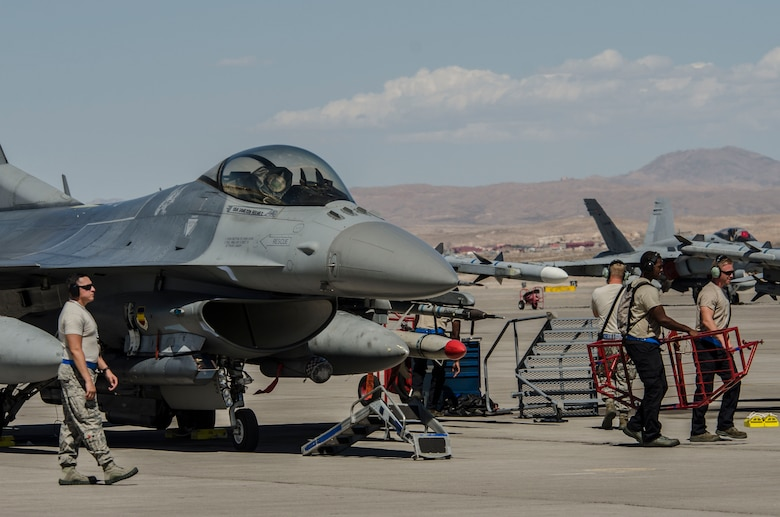U.S. Air Force maintainers from the 20th Fighter Wing at Shaw Air Force Base, S.C., ready an F‐16CM Fighting Falcon at Nellis Air Force Base, Nev., Aug. 13, 2016. The F‐16 played an intricate part of Red Flag 16‐4 the world's premiere combat training exercise. (U. S. Air Force photo by Tech. Sgt. Frank Miller/Released)
