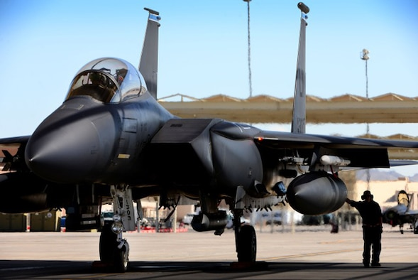 An F-15E Strike Eagle from the 492nd Fighter Squadron awaits clearance to taxi for a sortie in preparation for exercise Red Flag 16-4 at Nellis Air Force Base, Nevada, Aug 12. Red Flag is the U.S. Air Force's premier air-to-air combat training exercise and one of a series of advanced training programs that is administered by the U.S. Air Force Warfare Center and executed through the 414th Combat Training Squadron. (U.S. Air Force photo/ Tech. Sgt. Matthew Plew)