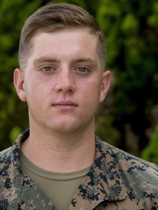 Cpl. Jordan Aaron Summerton stands in front of his barracks, on Camp Schwab, Okinawa, Japan, Aug. 10, 2016. He just finished packing up and is ready to return home from a six-month deployment in the Pacific. Summerton, a Colombia, South Carolina, native, is a mortarman with Headquarters and Service Company, 2nd Battalion, 2nd Marine Regiment, which supported III Marine Expeditionary Force under the unit deployment program. (U.S. Marine Corps photo by Lance Cpl. Amaia Unanue/ Released)