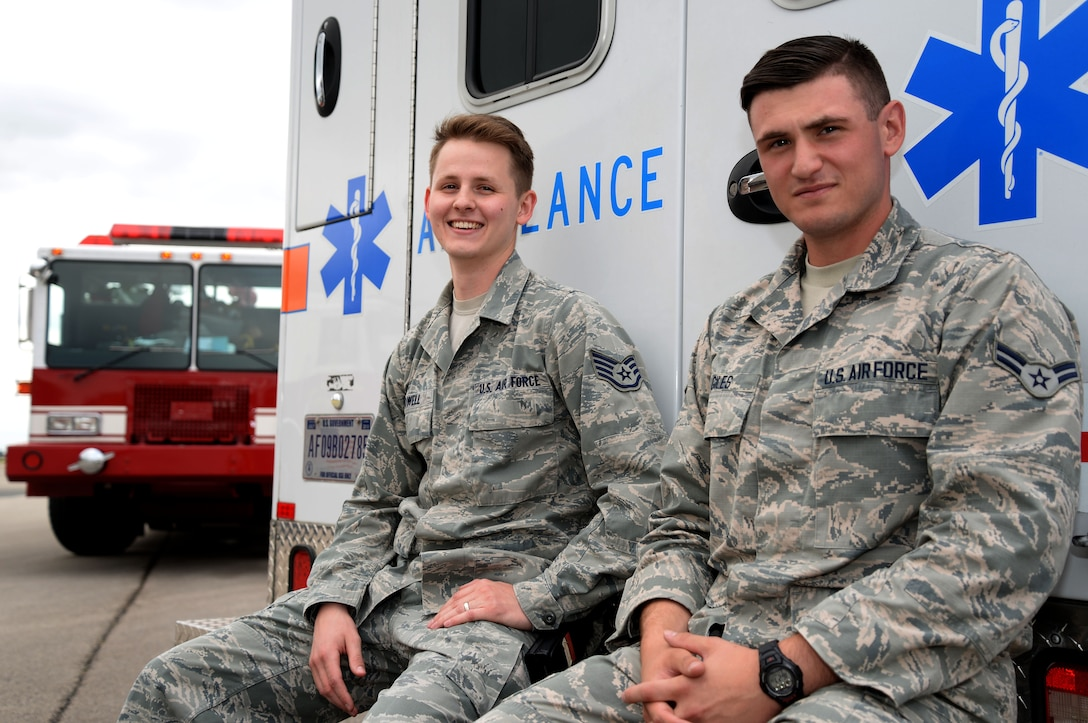 U.S. Air Force Staff Sgt. Jonathon Powell, left, and U.S. Air Force Airman 1st Class Andrew Giles, both 48th Medical Operations Squadron emergency services technicians, pose for a photograph after an exercise emergency response scenario Aug. 11, 2016, on RAF Mildenhall, England. The medics from RAF Lakenheath are assigned to the 100th Civil Engineering Squadron, which significantly cuts down emergency response time and creates a more dynamic training environment for both firefighters and medics. (U.S. Air Force photo by Senior Airman Justine Rho)