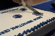 U.S Air Force Senior Master Sgt. John Agnew, 52nd Civil Engineer Squadron facility systems superintendent, cuts a cake during a senior NCO induction ceremony at Club Eifel on Spangdahlem Air Base, Germany, Aug. 12, 2016. The ceremony featured the recognition of 50 inductees, a dinner and speeches by 52nd Fighter Wing leaders. (U.S. Air Force photo by Airman 1st Class Preston Cherry/Released)