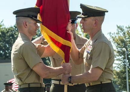 U.S. Marine Corps Col. Christian Wortman, commanding officer (CO), The Basic School (TBS), relinquishes command to U.S. Marine Corps Col. Mark Clingan at Camp Barrett, Quantico, Va., Aug. 12, 2016. The mission of TBS is to train and educate newly commissioned or appointed officers. (U.S. Marine Corps photo by Cpl. Alexander S. Norred/Released)