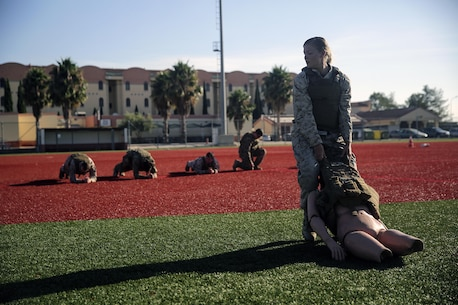 Cpl. Alayna Clark, a radio operator with Special Purpose Marine Air-Ground Task Force Crisis Response-Africa, drags a weighted mannequin during a combat lifesaver course at Naval Air Station Sigonella, Italy, August 4, 2016. During the four-day course, Marines learned to recognize injuries, perform the appropriate procedures and control the patient to prolong survivability until help arrives. (U.S. Marine Corps photo by Cpl. Alexander Mitchell/released)