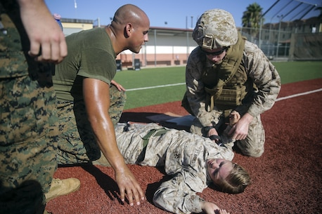 Lance Cpl. Conor Fredericks, an intelligence specialist with Special Purpose Marine Air-Ground Task Force Crisis Response-Africa, applies a tourniquet to a simulated injury during a combat lifesaver course at Naval Air Station Sigonella, Italy, August 4, 2016. During the four-day course, Marines learned to recognize injuries, perform the appropriate procedures and control the patient to prolong survivability until help arrives. (U.S. Marine Corps photo by Cpl. Alexander Mitchell/released)