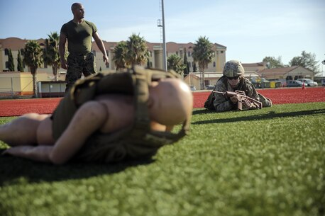 Lance Cpl. Conor Fredericks, an intelligence specialist with Special Purpose Marine Air-Ground Task Force Crisis Response-Africa, low crawls to his patient during a combat lifesaver course at Naval Air Station Sigonella, Italy, August 4, 2016. During the four-day course, Marines learned to recognize injuries, perform the appropriate procedures and control the patient to prolong survivability until help arrives. (U.S. Marine Corps photo by Cpl. Alexander Mitchell/released)