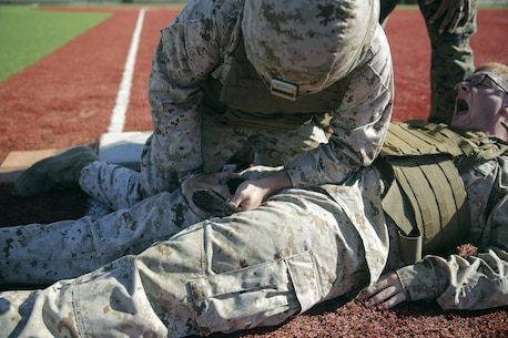 Lance Cpl. Matthew Little, an electrician with Special Purpose Marine Air-Ground Task Force Crisis Response-Africa, applies a tourniquet to a simulated casualty during a combat lifesaver course at Naval Air Station Sigonella, Italy, August 4, 2016. During the four-day course, Marines learned to recognize injuries, perform the appropriate procedures and control the patient to prolong survivability until help arrives. (U.S. Marine Corps photo by Cpl. Alexander Mitchell/released)